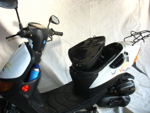 Moped with broken plastic hinge